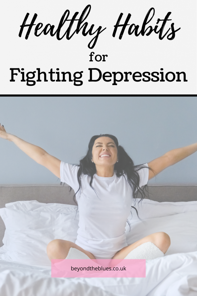 healthy habits for fighting depression, woman on bed raising arms in happiness