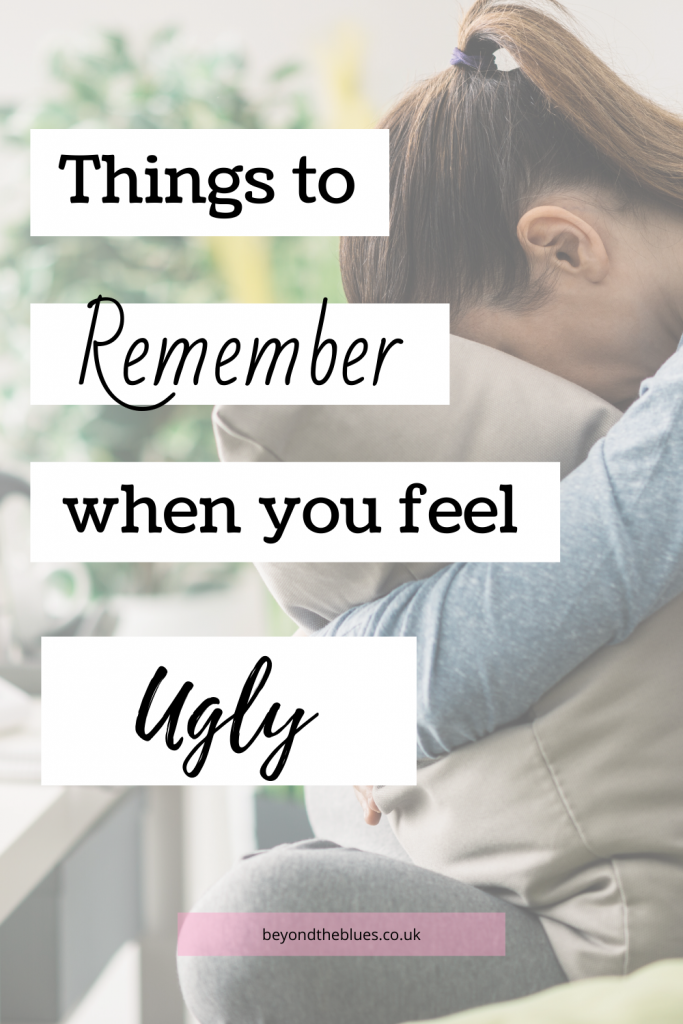 Things to remember when you feel ugly pin for Pinterest. A woman sitting with her head in a pillow.
